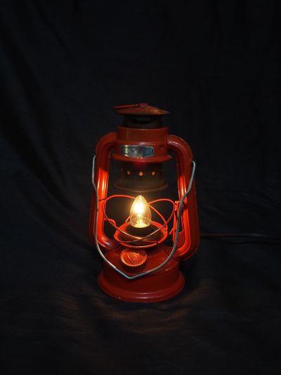 Lit lantern on black background