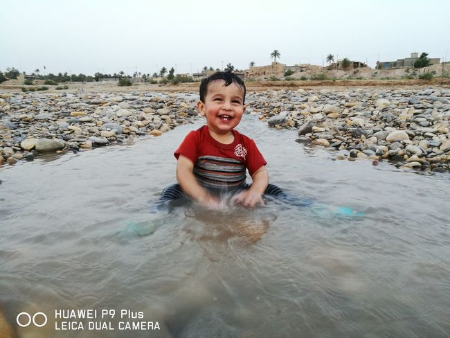 EyeEm Selects Portrait Child Water Smiling Childhood Cheerful Boys Happiness Looking At Camera Beach