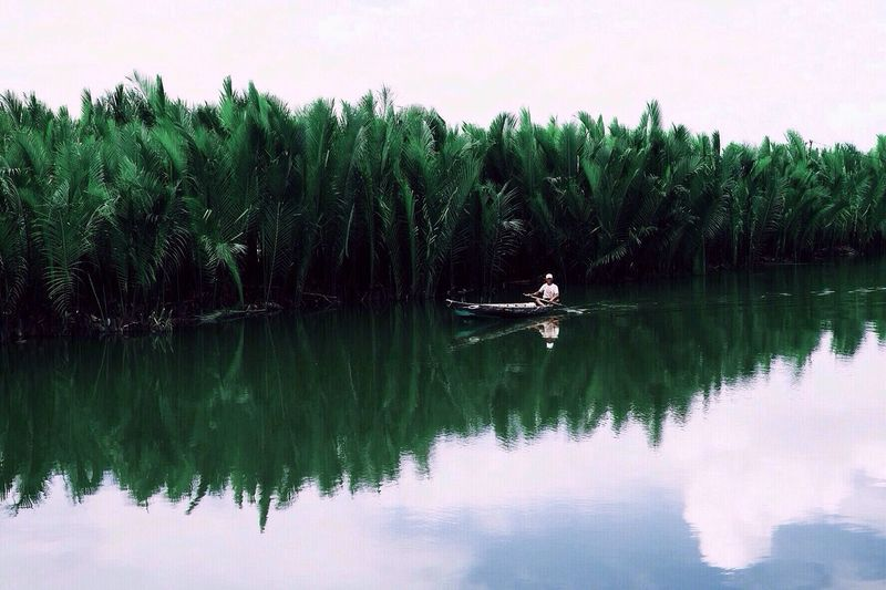 Boat sailing in lake