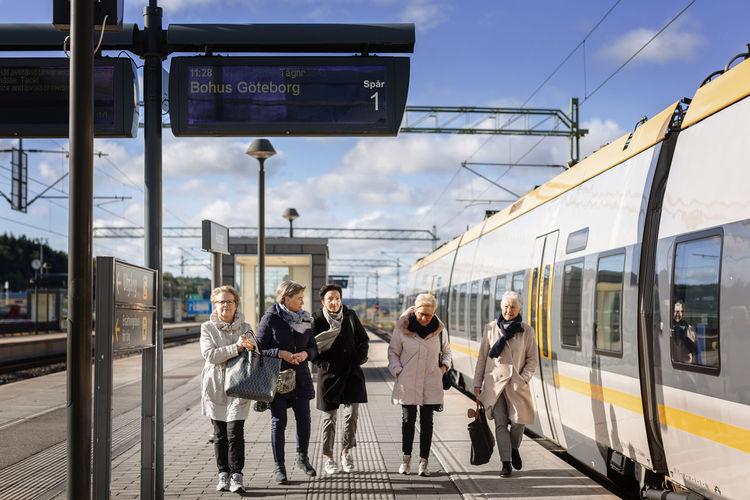 People walking on railroad station platform