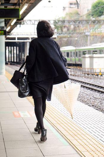 Rainy day travel Rear View Walking Women City Umbrella Rainy Days Windy Winter Platform Train Station Train Station Platform