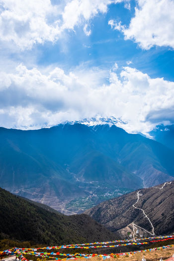Mountain Cloud - Sky Sky Mountain Range Scenics - Nature Beauty In Nature Non-urban Scene Landscape Environment Day Nature Tranquil Scene Tranquility Idyllic Outdoors Architecture Winter Snow No People Snowcapped Mountain Meili DeQin Yunnan China Tibet Fog Cold Cool