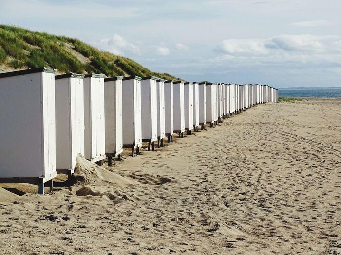 Public Restrooms On Beach Against Sky