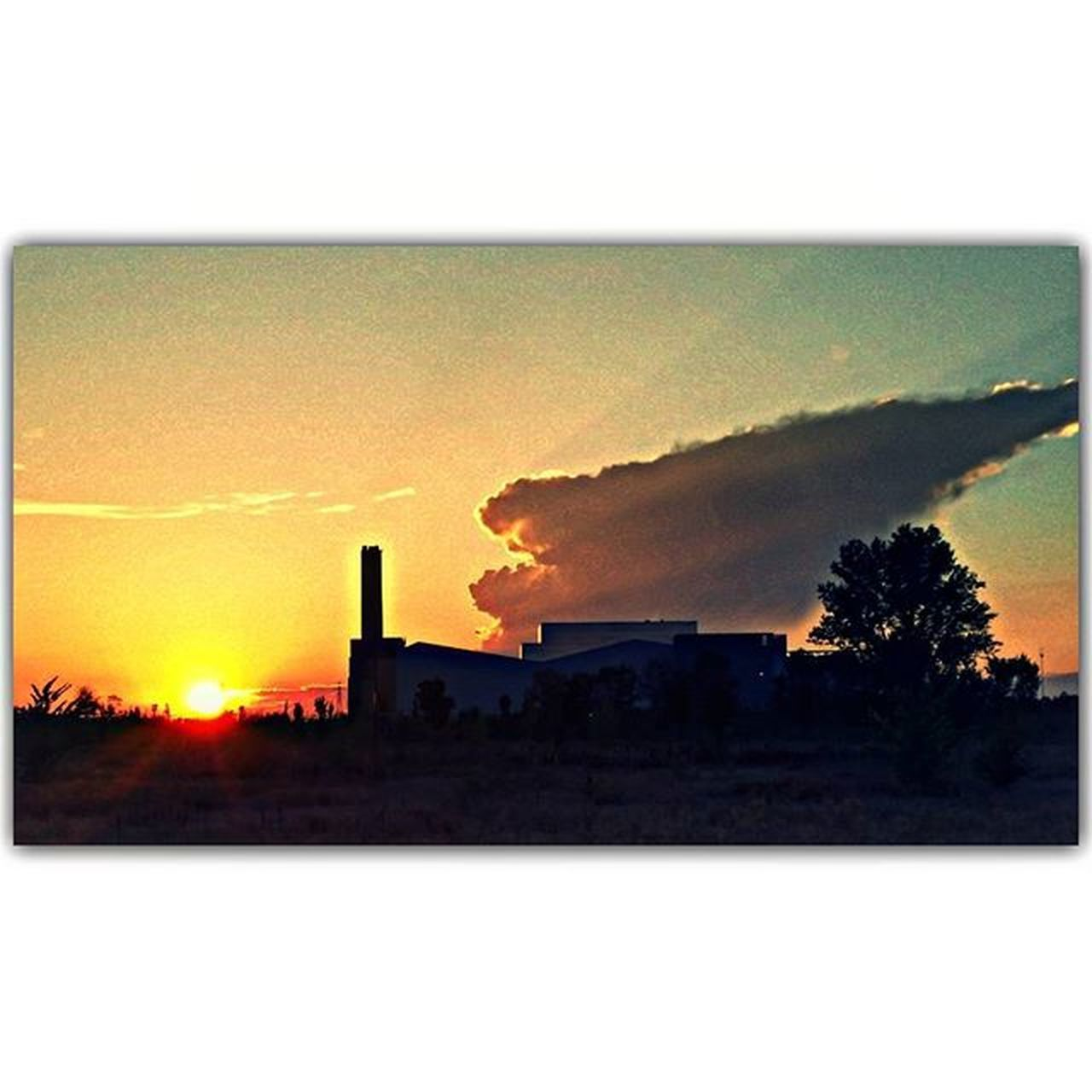air pollution, sunset, factory, industry, silhouette, smoke stack, pollution, built structure, architecture, no people, sky, outdoors, chimney, tree, building exterior, scenics, nature, clear sky, global warming, beauty in nature, day