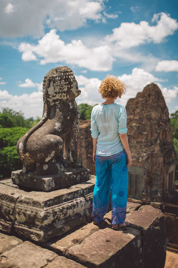 Siem Reap Cambodia Angkor Curly Hair Girl One Person Sky History Cloud - Sky Day Architecture Rear View Casual Clothing Full Length The Past Ancient Leisure Activity Built Structure Real People Religion Standing Travel Destinations Tourism Travel Hair Hairstyle Outdoors