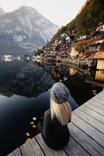 Architecture Mountain Water Building Exterior Built Structure Nature Rear View Lake Day Sky Mountain Range Pier Real People City Building Women One Person Beauty In Nature Scenics - Nature Outdoors Hairstyle Looking At View Blond Hair Young Women Standing Autumn Mood It's About The Journey Moments Of Happiness