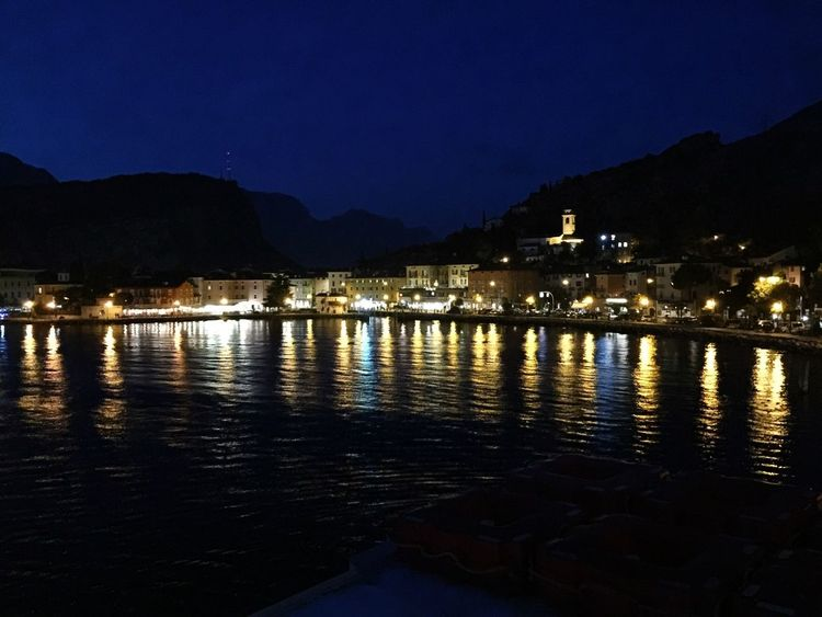 Night Water Illuminated Reflection Architecture Building Exterior Built Structure No People Nature Sky Outdoors Waterfront Beauty In Nature River Mountain Scenics Riva Del Garda Italy Nighttime Nighttime Lights Nighttime Photography Reflextion