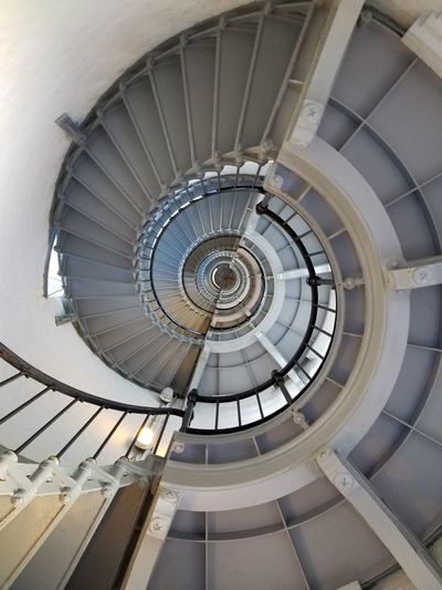 A light house circular staircase Lighthouse Spiral Staircase Steps And Staircases Architecture Spiral Staircase Steps Indoors  Built Structure High Angle View Repetition Railing Stairs No People Coil Circle Building Story Bannister Day