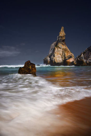 Sea Wave Water Rock - Object Nature Outdoors Landscape Travel Destinations Long Exposure Night Scenics Cloud - Sky No People Beach Beauty In Nature Sky Beachphotography Rock Formation Praia Da Ursa Popular Eye4photography  Popular Photos Ursa Beach Sintra (Portugal) Sunset