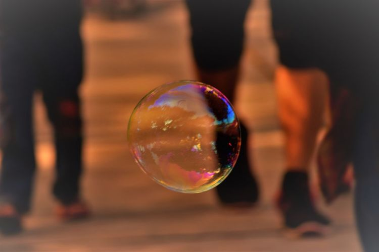 Bubble Fragility Vulnerability  Mid-air Focus On Foreground Sphere Transparent Multi Colored Soap Sud Nature Reflection Day Human Body Part Standing Incidental People Photography Beauty In Nature Capture Tomorrow EyeEmNewHere It's About The Journey The Art Of Street Photography