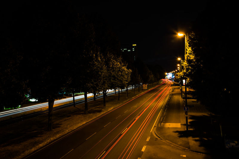 Blurred motion of car moving on road at night