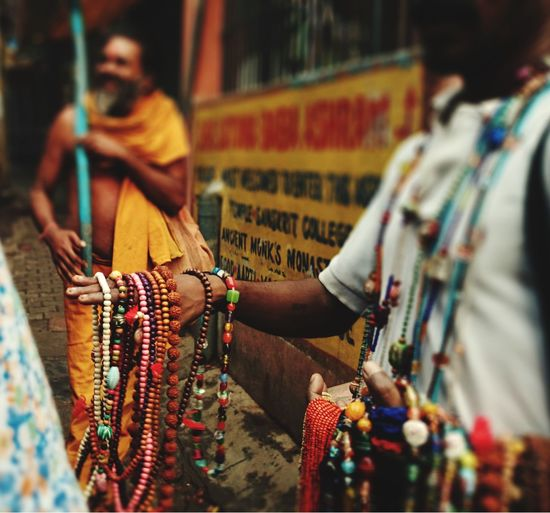 Man selling bead necklaces