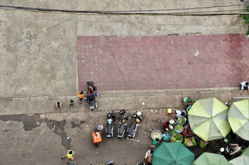 High angle view of market stalls on sidewalk