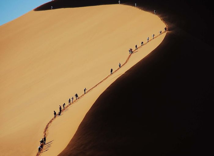 Dune ascent Namibia Desert Dunes Beauty In Nature Climb Ascent Trek Sossusvlei Graphic Image Figures In A Landscape EyeEmNewHere Fresh on Market 2017 The Great Outdoors - 2017 EyeEm Awards EyeEm Selects Lost In The Landscape An Eye For Travel
