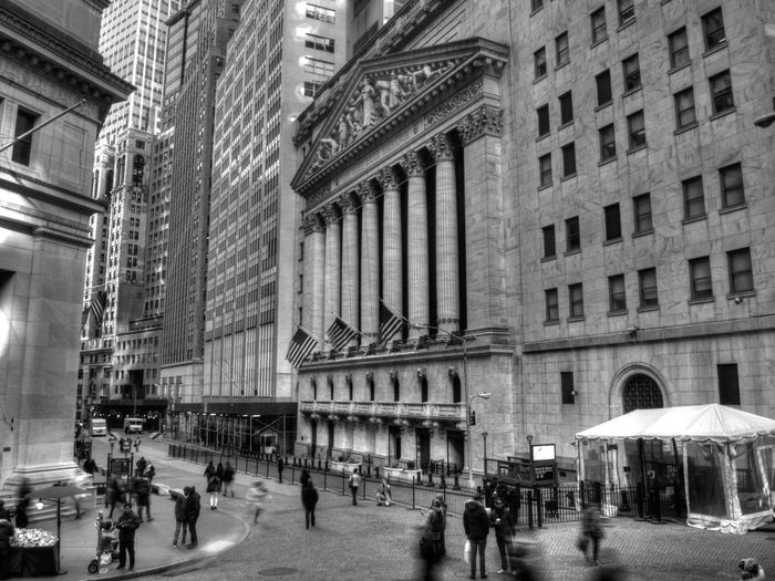 People on street by new york stock exchange at lower manhattan in city