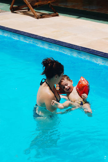 Mother with son in the swimming pool