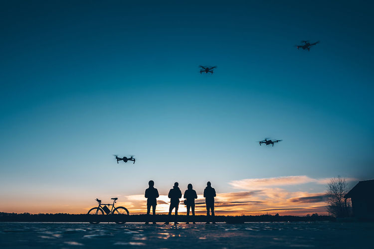 Man with drones Drone  Drones Silhouettes Toys Winter Aerial View Aerospace Industry Air Vehicle Airplane Blue Clear Sky Flying Frozen Water Group Of People Helicopter Low Angle View Mavic Pro Men Mid-air Mode Of Transportation Nature Real People Silhouette Sky Sunset Transportation Travel Water