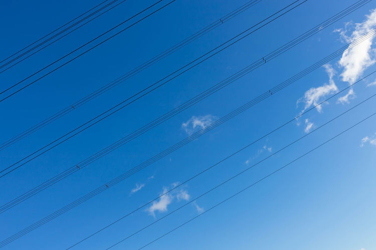 low angle view of power lines against blue sky Backgrounds Beauty In Nature Blue Cable Cloud - Sky Connection Day Electricity  Fuel And Power Generation Full Frame Low Angle View Nature No People Outdoors Parallel Power Line  Power Supply Sky Stromleitungen Januar Technology Telephone Line Tranquil Scene Tranquility