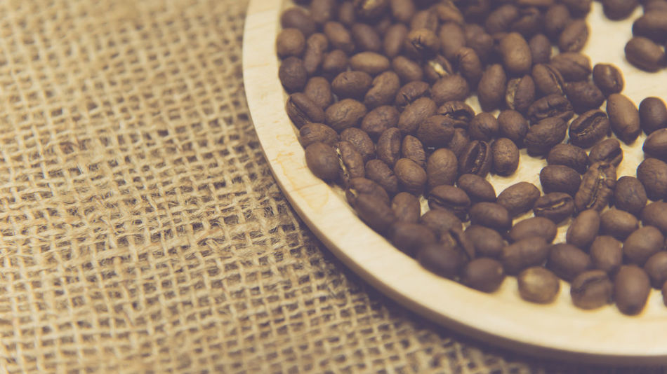 Close-up Coffee - Drink Coffee Bean Food Food And Drink Freshness Group Of Objects Indoors  No People Raw Coffee Bean Roasted Coffee Bean Selective Focus Still Life Table