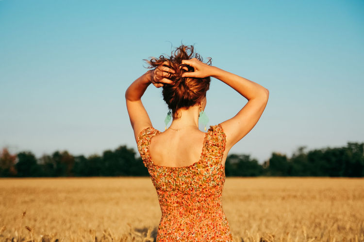 Agriculture Country From Behind Lifestyle Portrait Of A Woman Rear View Wheat Field Beauty In Nature Country Life Environment Field From The Back Horizon Nature One Person Outdoor Outdoors Real People Red Hair Rural Scene Standing Sustainability Young Women Inner Power