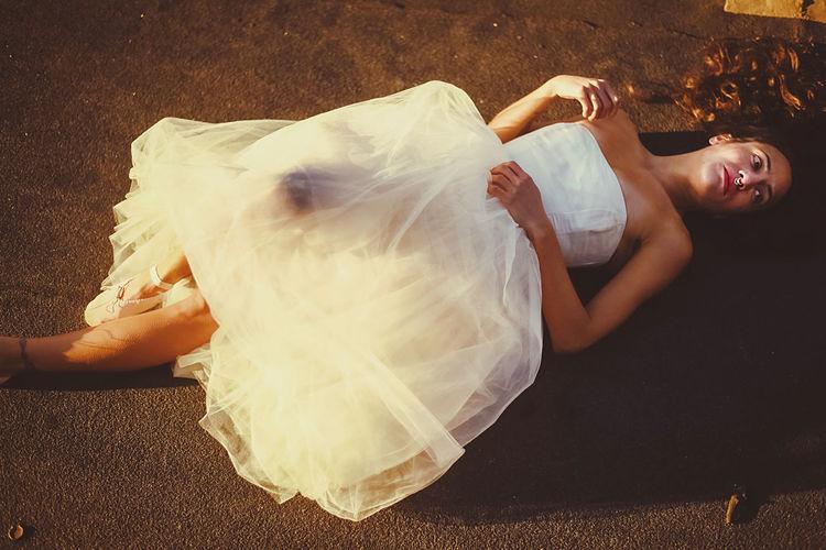 High angle view of woman lying down on floor