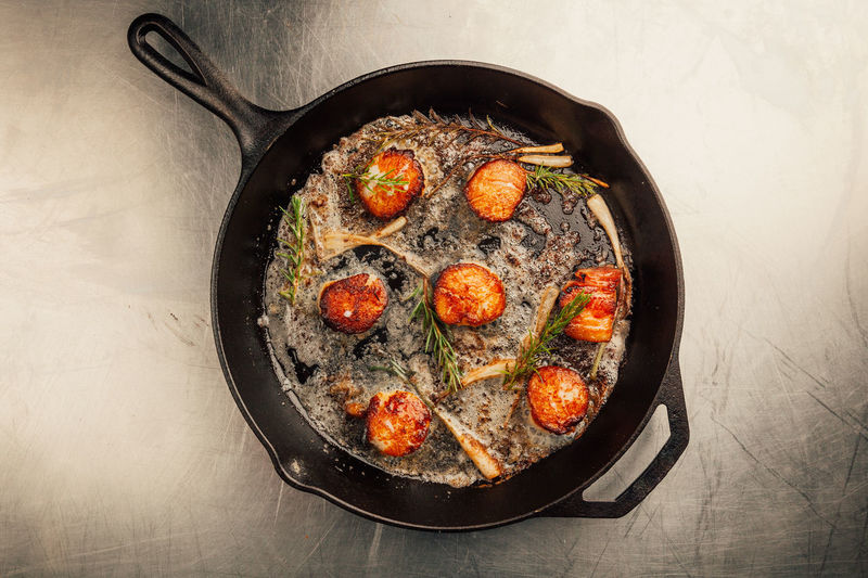 Scallops in a cast iron pan. Cooking Cuisine SHELLFISH  Seafood Cast Iron Cooked Cooking Pan Delicious Dinner Directly Above Fine Dining Food Freshness Frying Pan Herb Household Equipment Meal No People Ready-to-eat Restaurant Scallop Seared Skillet- Cooking Pan Stainless Steel