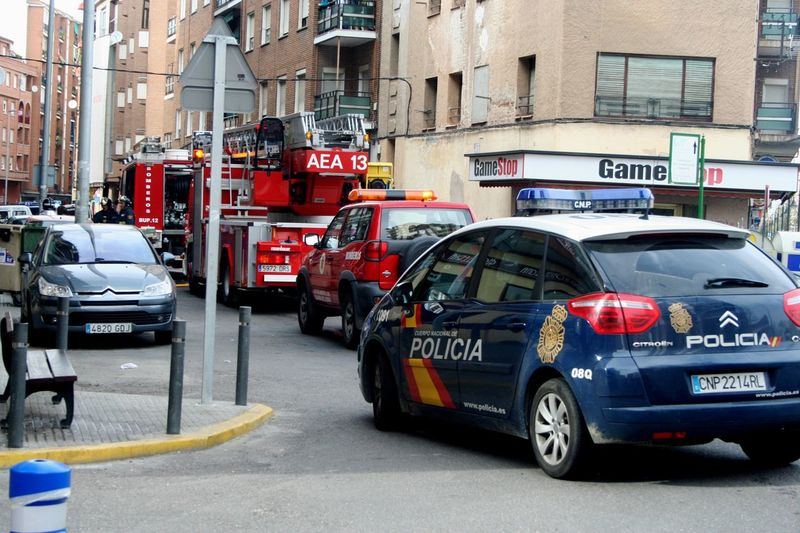 Architecture Bomberos Building Built Structure City City Life City Street Day Fire Truck Land Vehicle Mode Of Transport Outdoors Parked Parking Police Policecar Road Stationary Transportation Vehicle