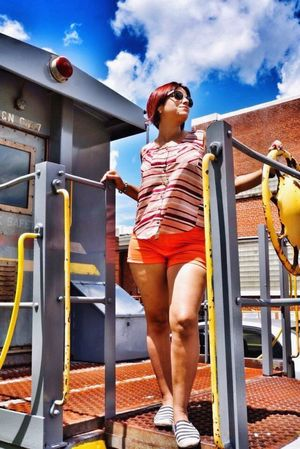 Young Women Real People Red Hair Wearing Sunglasses In Shorts Locomotive Railroad Express Conductor