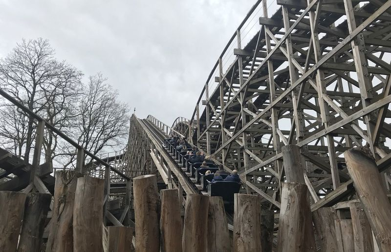 Attraction theme park the Efteling, Kaatsheuvel, the Netherlands Sky Built Structure Architecture Low Angle View No People Cloud - Sky Nature Day Tree Building Exterior Wood - Material Metal Outdoors Bare Tree Industry Boundary Plant Barrier Fence Building