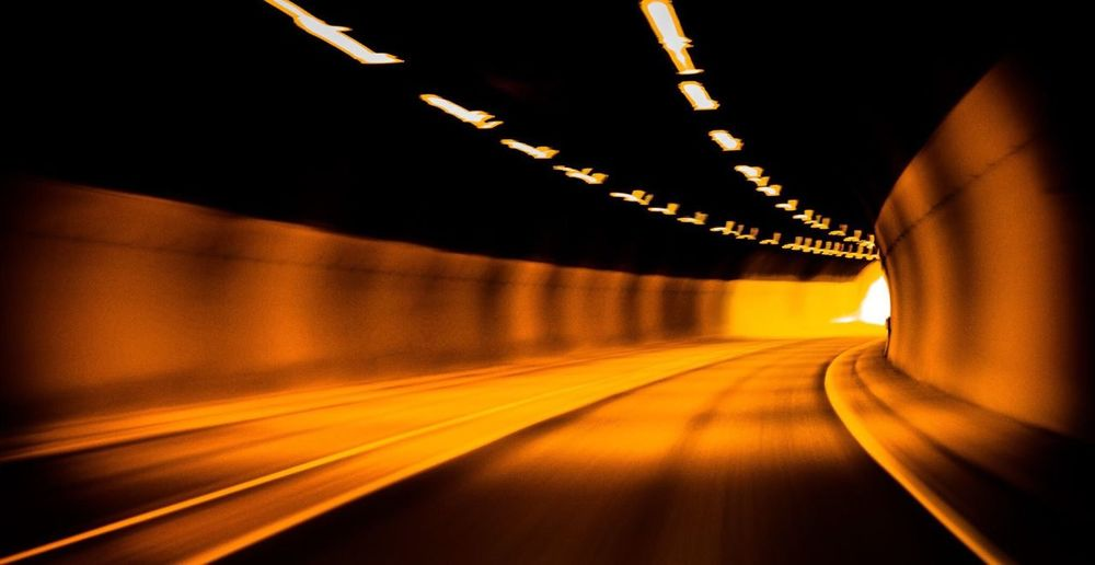 Light trails on road in tunnel