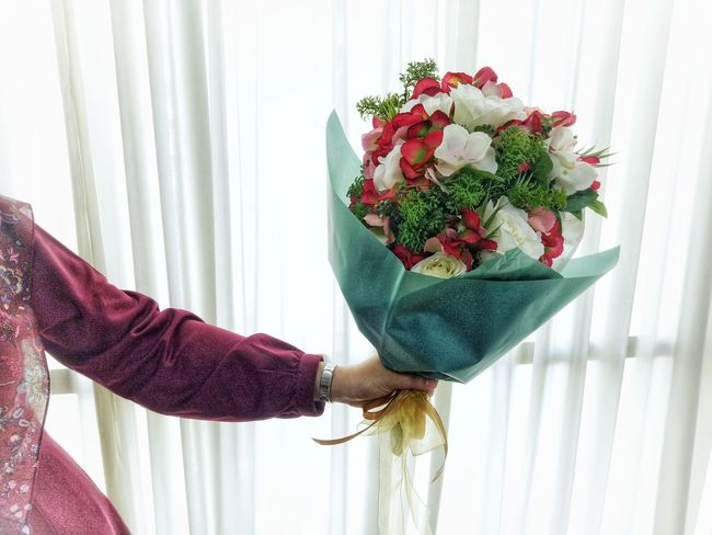 Behind the curtain.... Flowers Artificialflowers Flowerbouquet Celebration Human Hand Bouquet Indoors  Lifestyles Holding Giving Gift Curtain
