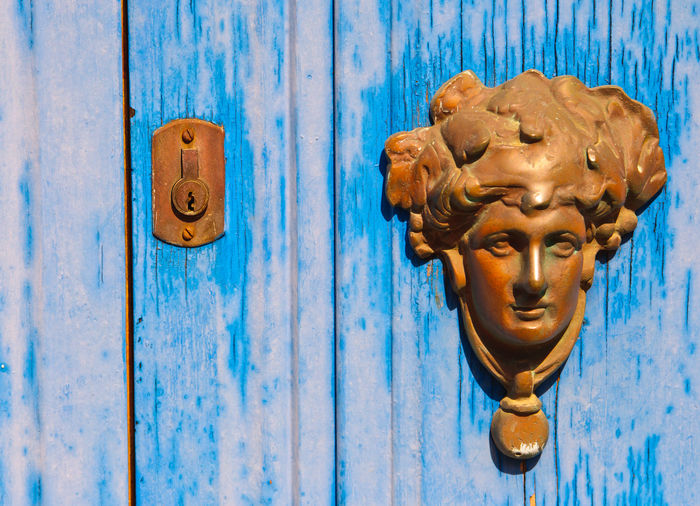 Close-up of door knocker on sunny day