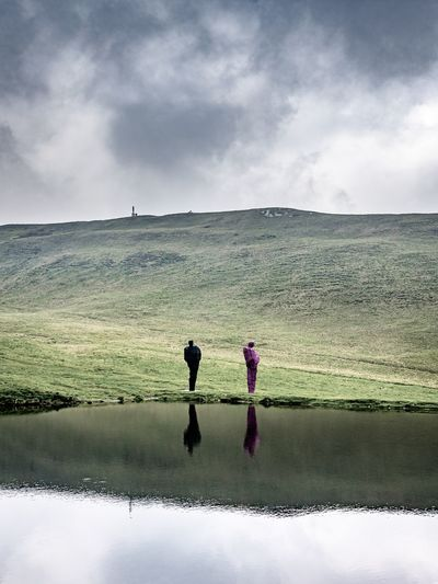 Real People Sky Cloud - Sky Beauty In Nature Water Nature Two People Lifestyles Women Scenics - Nature Day Leisure Activity Men Togetherness Non-urban Scene Landscape Full Length Adult Land Outdoors