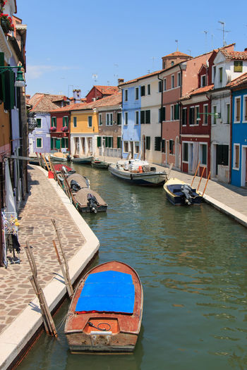 Burano's Colored Houses, Venice Architecture Blue Boat Building Building Exterior Built Structure Burano, Italy Canal City Colored Day Houses Italy Mode Of Transport Nautical Vessel Outdoors Residential Building Residential District Residential Structure Sky Town Traditional Houses Transportation Venice, Italy Water