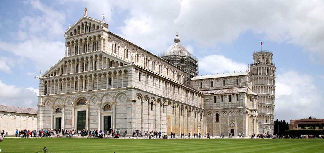 People At Campo Dei Miracoli Against Sky