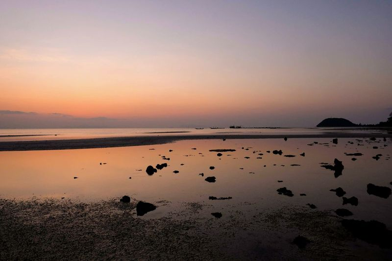 reflection of the low tide beach when sunset Twilightscapes Reflections In The Water Water Low Tide Sunset Beach Sun