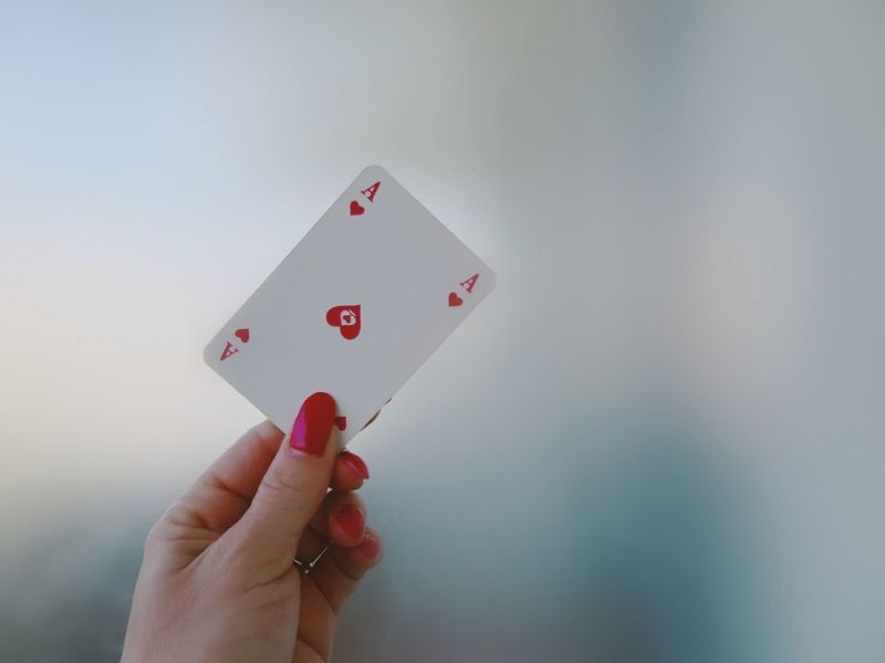 Nail Polish Red Adult Cards Chance Close-up Day Gambling Heart Holding Human Body Part Human Finger Human Hand Leisure Activity Leisure Games Luck One Person Outdoors People Personal Perspective Real People Red Nails Winner