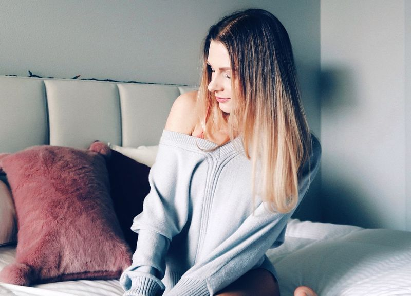 Sweater Sweaterweather One Person Sitting Indoors  Furniture Lifestyles Sofa Women Real People Home Interior Adult Young Women Females Young Adult Casual Clothing Emotion Hairstyle