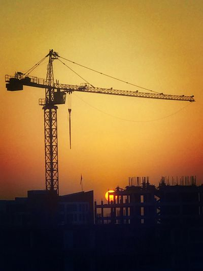 Sunset Development Architecture Construction Site Built Structure Silhouette Crane Crane - Construction Machinery Building Exterior No People Outdoors Industry City Sky Progress Construction Site Silhouette Golden Hour Man Made IPhoneography IPhone 7 Plus