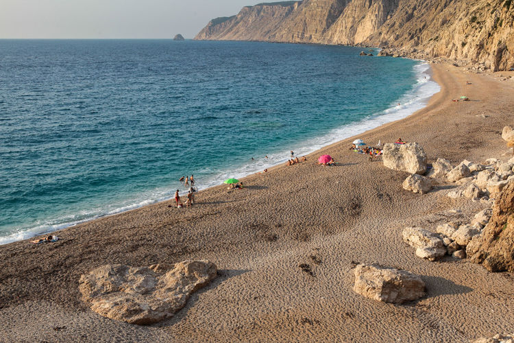Platia Ammos Beach with few people Sea Water Beach Land Sand Group Of People Scenics - Nature Beauty In Nature Real People Nature Holiday Vacations Trip Day Leisure Activity Lifestyles High Angle View Horizon Over Water Men Outdoors Rocks Wave