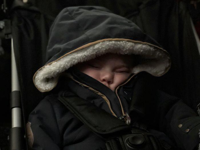 Close-Up Of Cute Baby Sleeping In Stroller