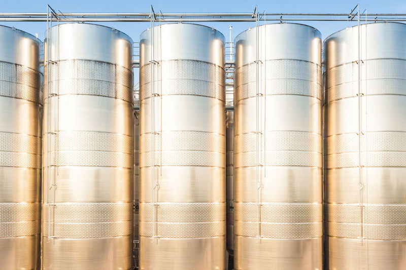 Series of stainless steel containers for wine, the sunset sun Agriculture Factory Fermentation Industrial Man Made Object Metal No People Repetition Silos Stainless Steel  Storage Tanks Technology Wine Winery