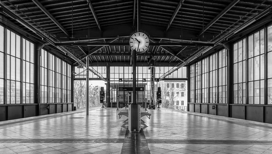 Black And White Street Photography Streetwise Photography S-bahnhof Subway Station Public Transport Indoors  Architecture Ceiling Built Structure Clock Time Day Railroad Station Lighting Equipment Building Flooring Window Transportation Empty Railroad Station Platform Full Length Hanging Transportation Building - Type Of Building Tiled Floor Electric Lamp