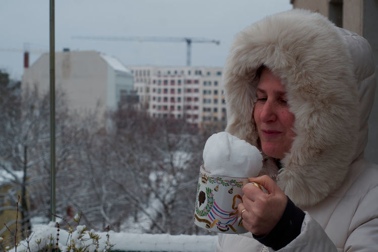 Young man drinking coffee in winter