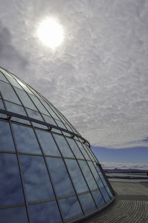 Iceland Perlan Iceland Alternative Energy Architecture Built Structure Cloud - Sky Day Fuel And Power Generation Glass Dome Low Angle View Modern Nature No People Outdoors Perlan Perlan Reykjavik Sky Solar Energy Solar Equipment Solar Panel Sun Sun Reflection On Glass Dome Sunlight