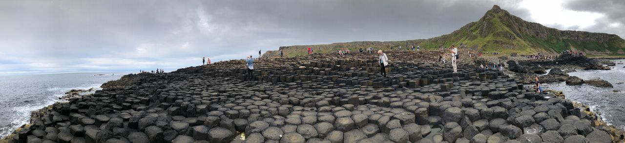 The Giant's Causeway Antrim Coast Antrim Finn McCool Basalt Columns Giant's Causeway People Walking  Sky History The Past Nature Ancient Cloud - Sky Travel Destinations Travel Mountain Tourism Panoramic Land Group Of People