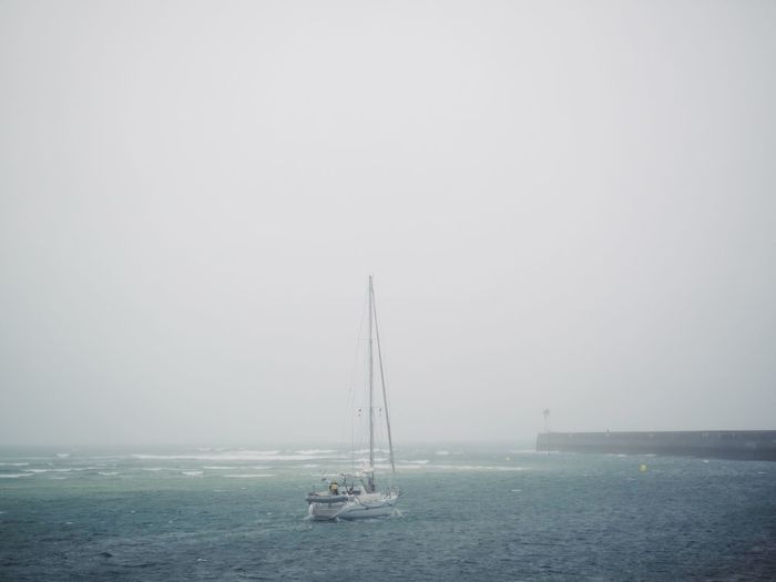 Foggy Morning Sea Water Sky Nautical Vessel Transportation Sailboat Horizon Over Water Copy Space Horizon Scenics - Nature Mode Of Transportation Beauty In Nature Tranquil Scene Waterfront Outdoors Nature