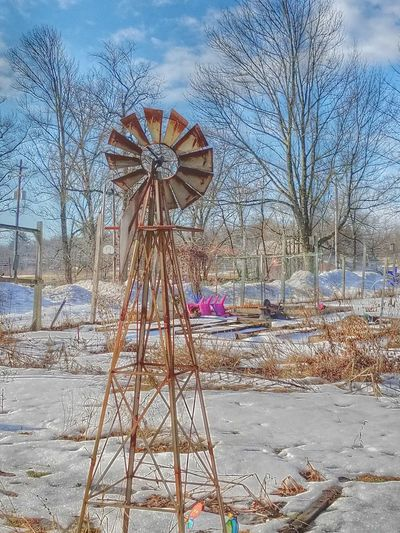 Sky Outdoors Water No People Amusement Park Day Ferris Wheel Nature Wind Mill Garden Snow Trees And Sky