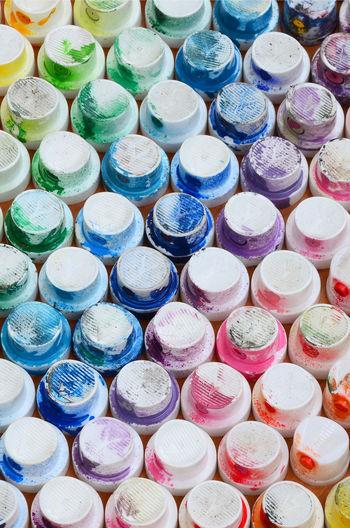 Full frame shot of multi colored bottle caps on table