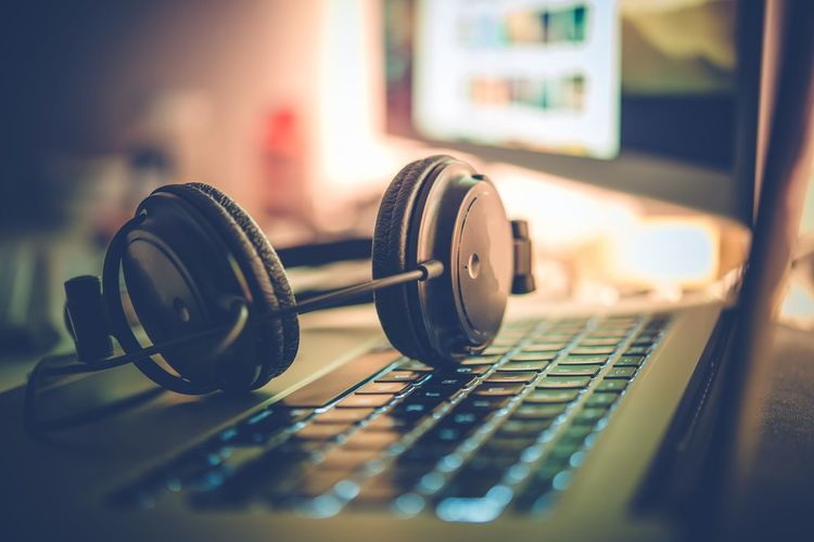 Digital Music Creation Theme with Professional Headphones on the Computer Keyboard. Headphones Listening Music Close-up Creation Day Indoors  Internet Laptop Listen Music Musical Instrument No People Producer Recording Studio Selective Focus Technology